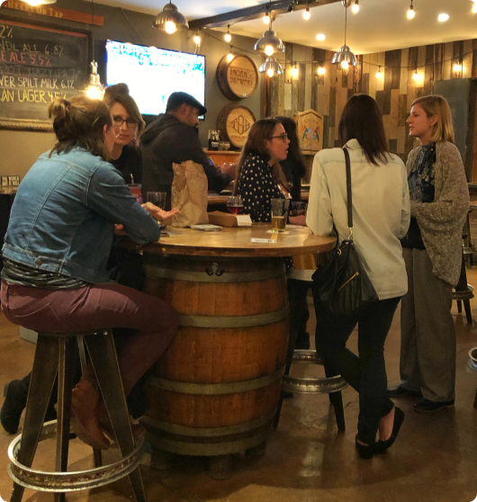 Emerging Museum Professionals networking at a happy hour event.